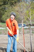 Loni is having a lot of fun spreading compost.