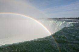 The beautiful scenery of a rainbow over the Horseshoe Falls in Canada
