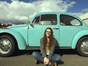 Emilia with her VW Beetle