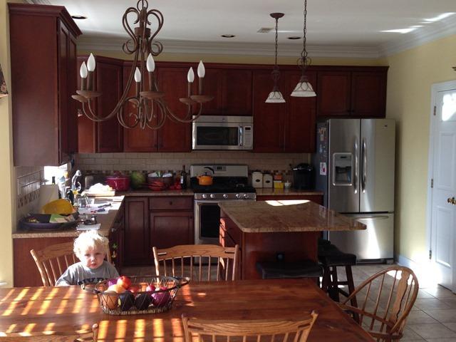 kitchen island lighting fixtures hood fans choosing light that work together - emily ...