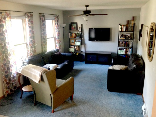 living room with carpet oak and white furniture give take the blue emily a clark