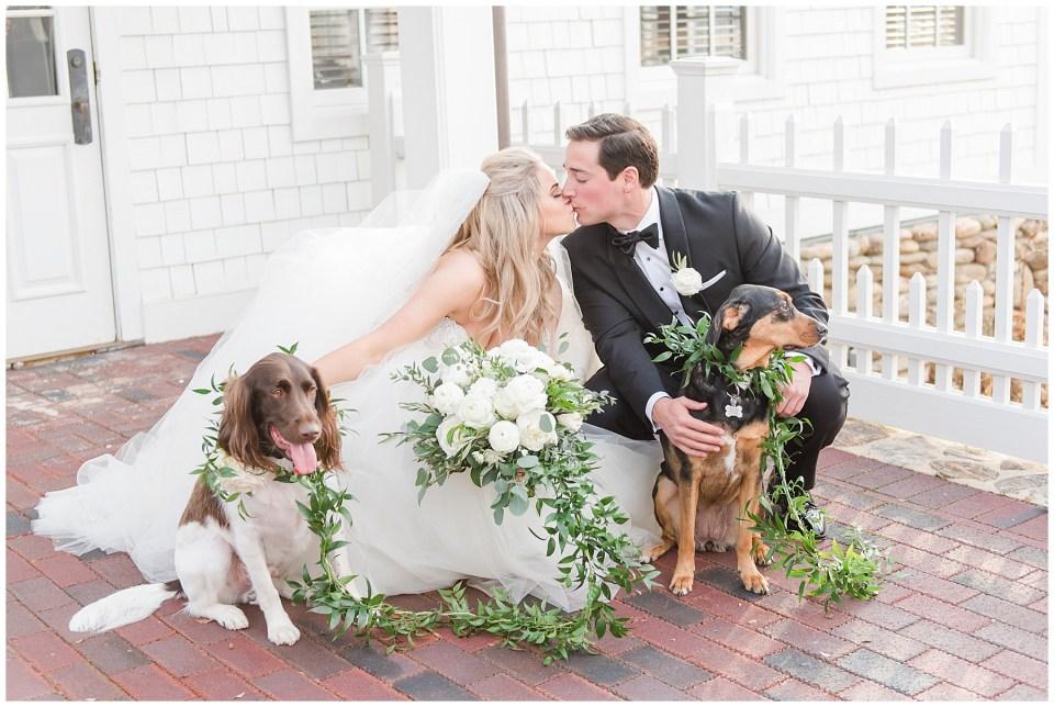 wedding photo dogs with greenery garland