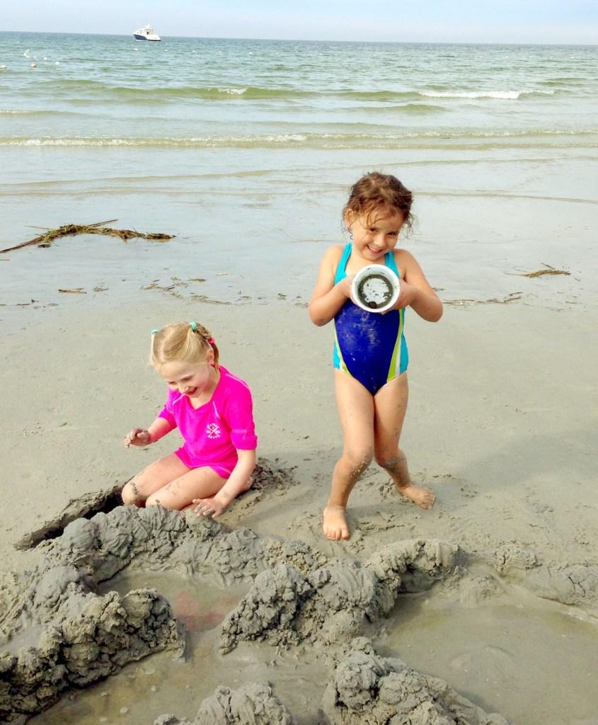 Proud kids of their beach house