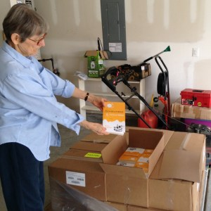 Mom holds up a book out of the box