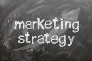 "the words ""marketing strategy"" written on a chalkboard"