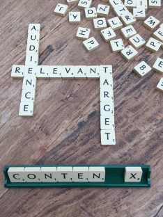 scrabble pieces spelling audience, relevant, target, and content