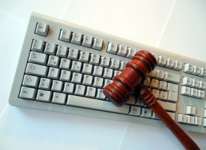 judge's gavel atop keyboard