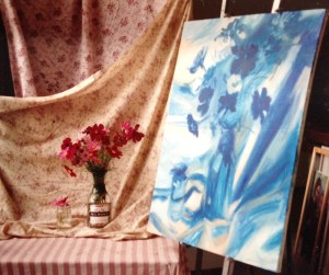 a vase of flowers, and a painting of the flowers with only blue paint