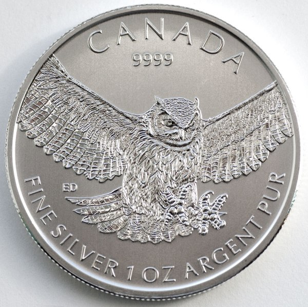 My photo of the Great Horned Owl bullion coin I designed.