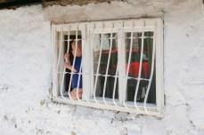 Boy in the windowsill, Novi Pazar.