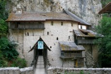 Crna Reka Monastery extends back into caves in the cliffside. The only way to reach the stone facade is to cross a bridge over a deep canyon.
