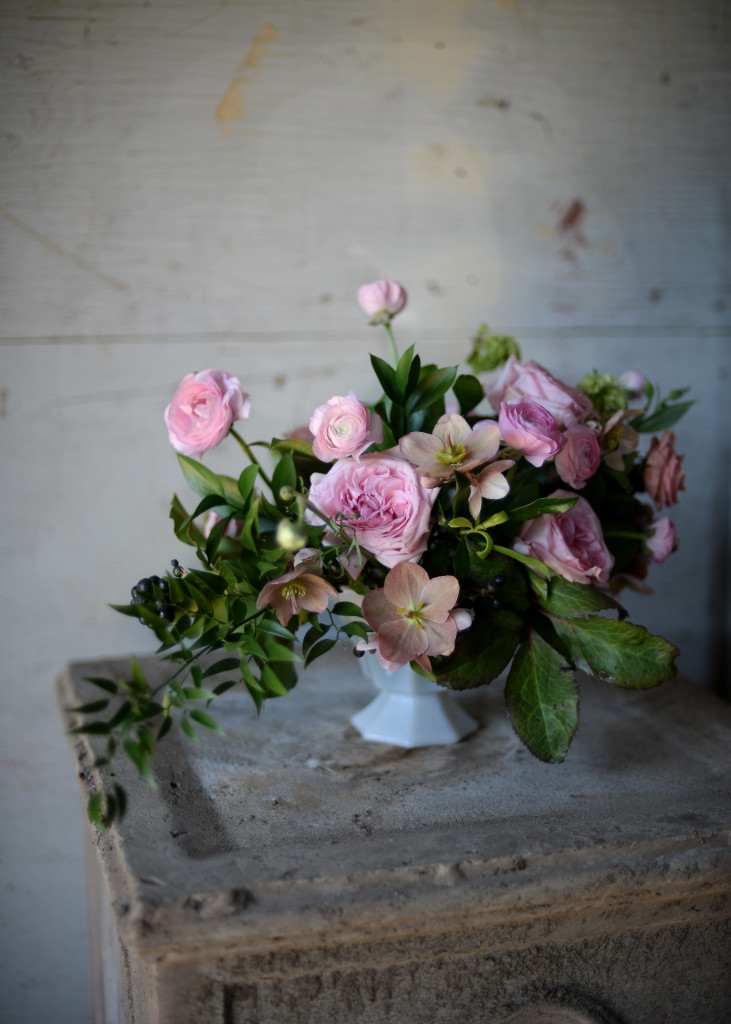 Loose Centrepiece Arrangement featuring hellebores and garden roses