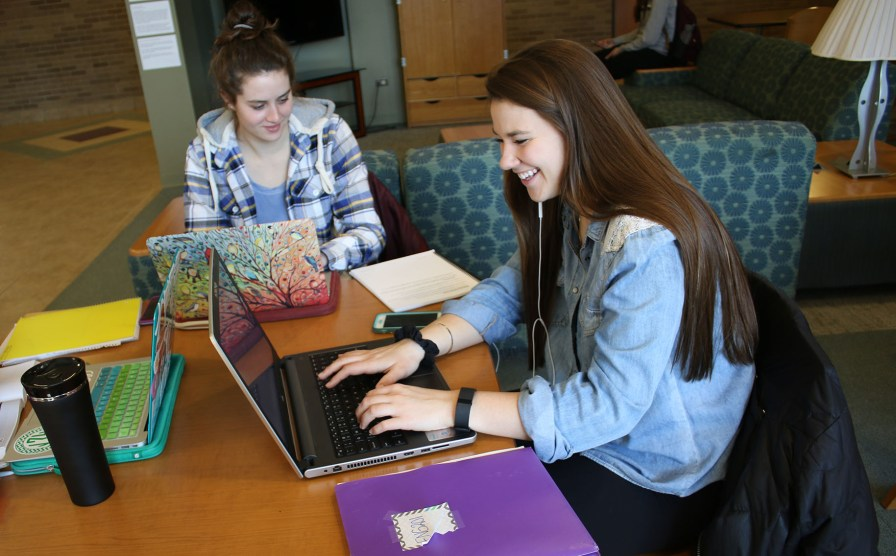 Marissa Dunn, right, works on homework, Saxe/Celani Lobby, on the campus of Central Michigan University, Monday, February 27, 2017.