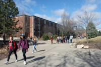 Students pass Brooks Hall between classes on the Campus of Central Michigan University.