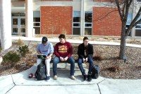 From left to right, Dayton Wallis, Logan Enders and Kenny Pappas sit outside Anspach Hall on the Campus of Central University, Mount Pleasant, Michigan, Thursday, February 23, 2017.