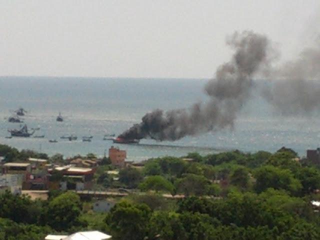 Boat burning in Puerto Lopez bay