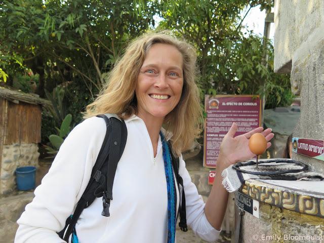 Emily balancing an egg at the equator