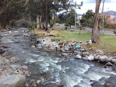 Washing laundry in Tomebamba River, Cuenca, Ecuador