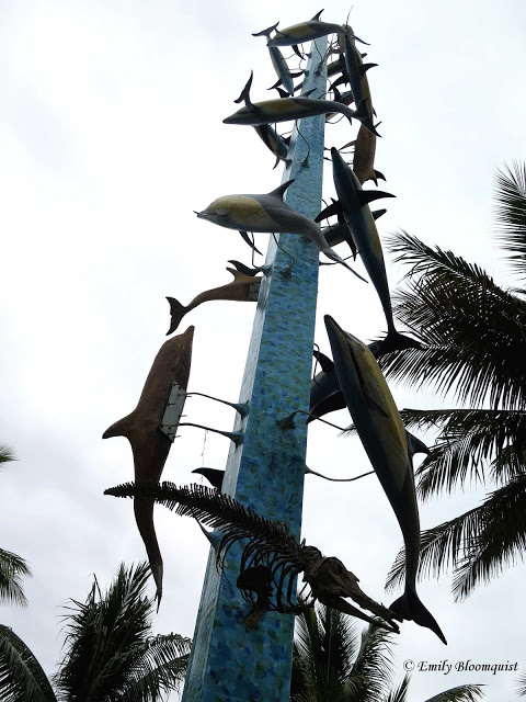 Dolphin statue in front of Hosteria Mandala