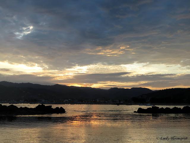 Sunrise over Puerto Lopez reflecting in ocean