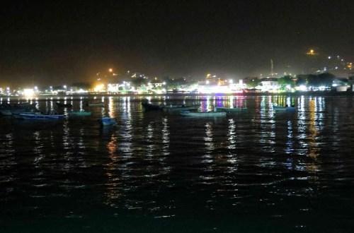 Puerto Lopez malecon lights reflecting off ocean