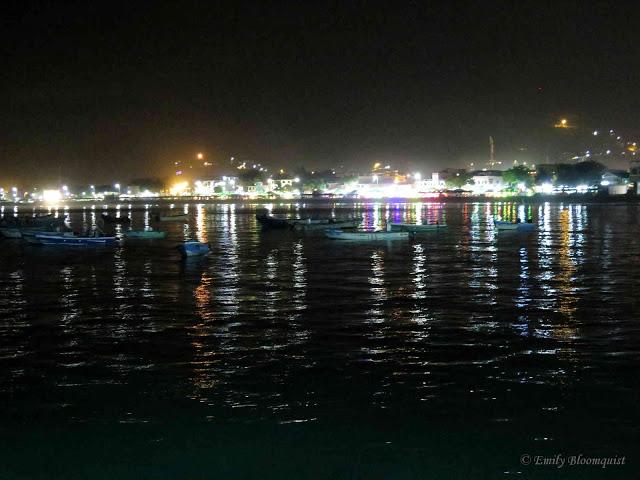 Puerto lights reflecting off ocean