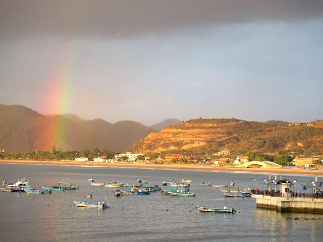 Sunset rainbow over Puerto Lopez