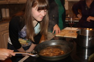 Annelise smells the heavenly aroma wafting from the reduction sauce as it simmers