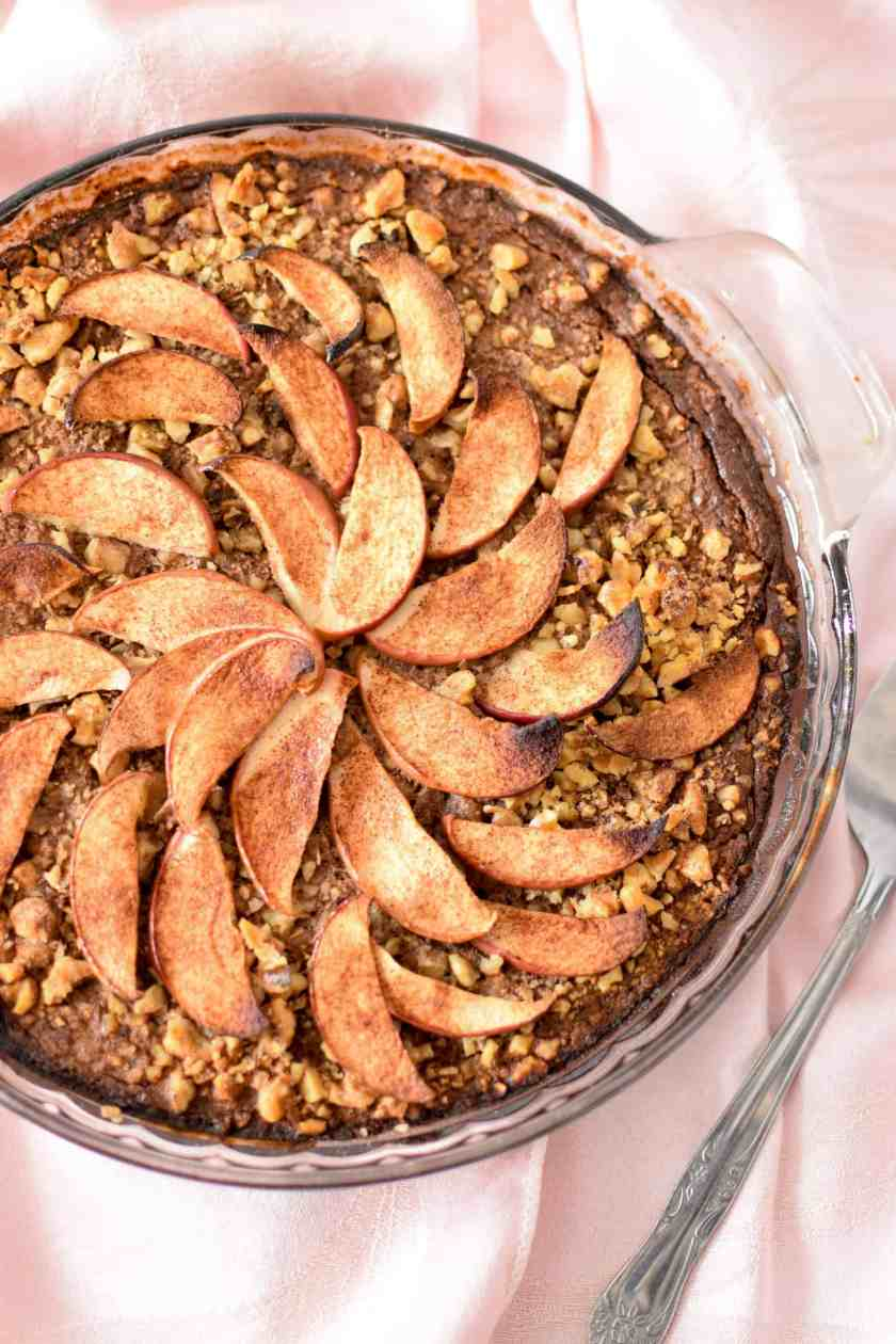 Spice up your breakfast routine with this simple. whole-food, nutrient dense Apple & Cinnamon Baked Oatmeal Cake!