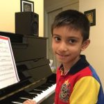 boy student at piano