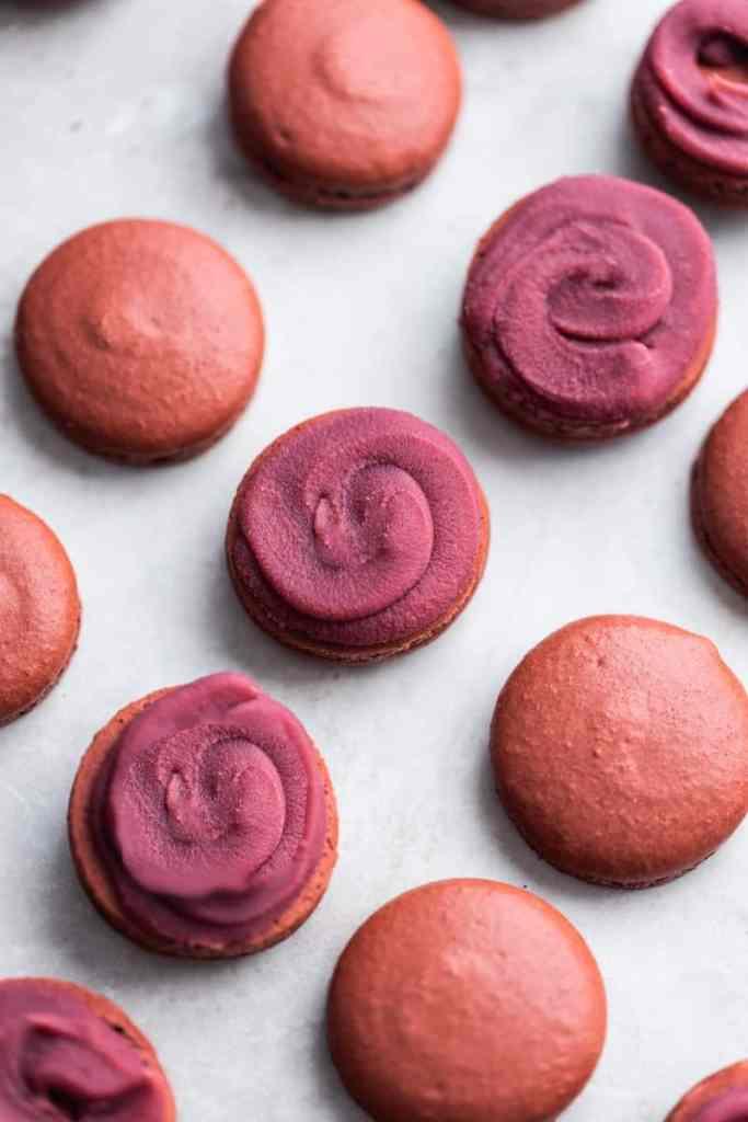 Filled raspberry macaron shells