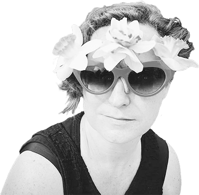 Emily, in black and white, with flowers in her sunglasses