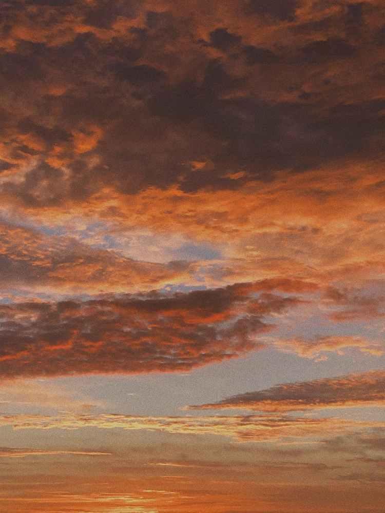 photo of orange cloudy sky