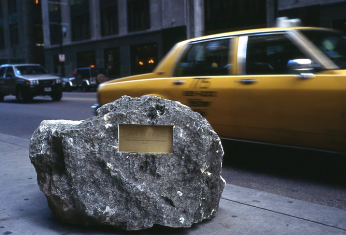 100 limestone boulders with the names of women from the city. (Chicago - downtown circle) - the boulders appeared overnight.