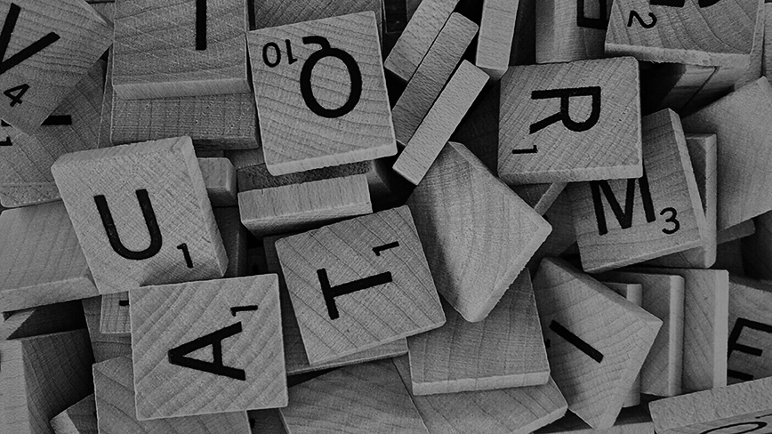 a black and white photo of scrabble tiles