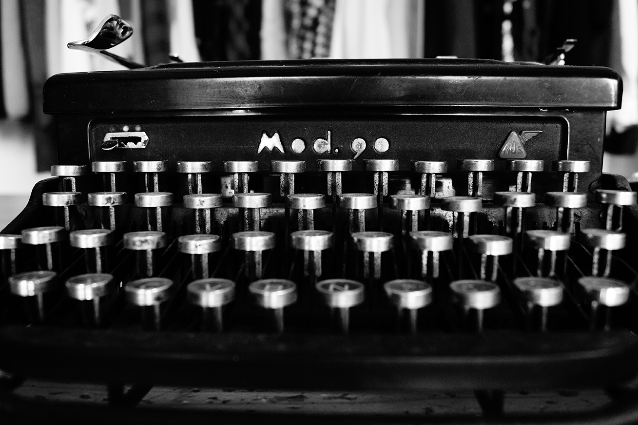 Black and white photo of typewriter keys