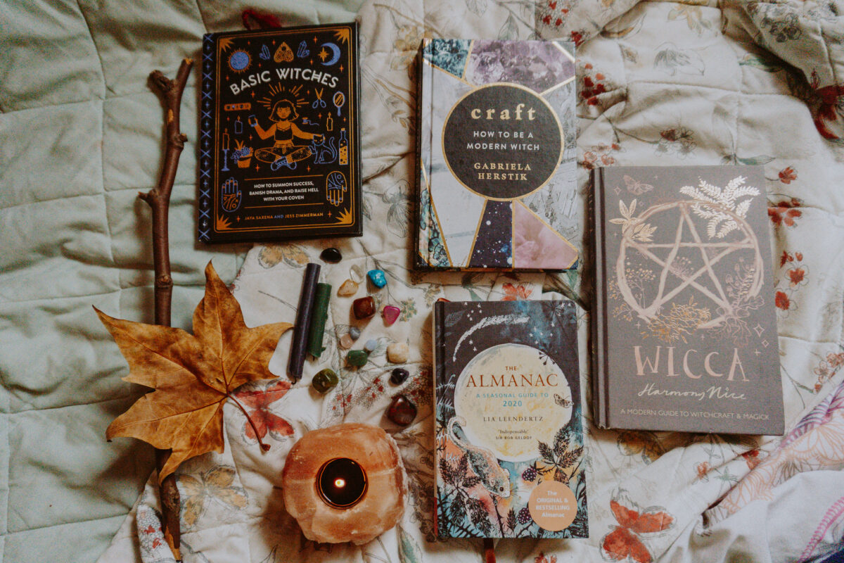 Books about Witchcraft, crystals and candles.