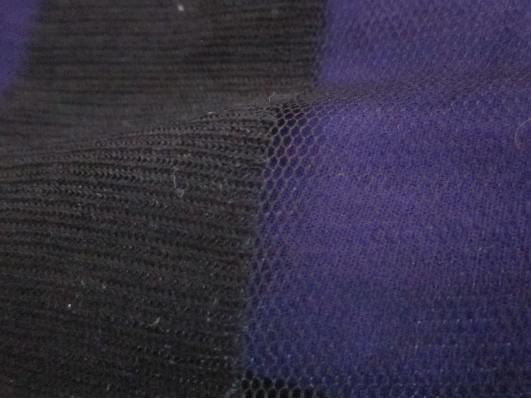 A close up of a black and purple dress