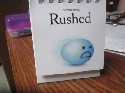 """A blue face looking nervous with the caption """"current mood: Rushed"""""""