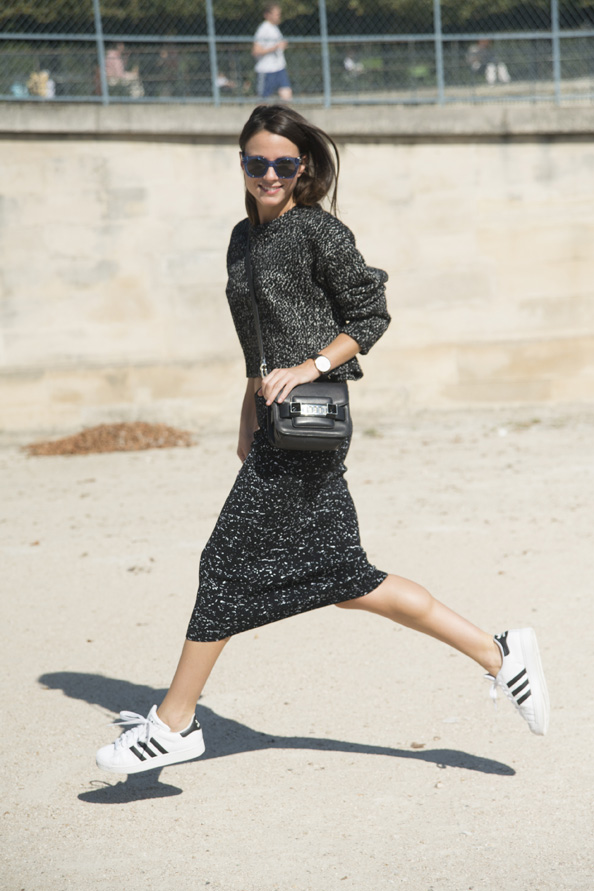 Fashion Buyer and Blogger Zina Charkoplia is wears a Proenza Schouler bag, top and skirt, Adidas trainers and Marc Jacobs sunglasses.
