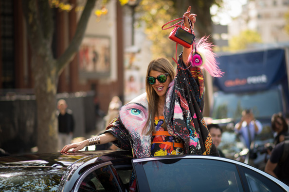 Anna Dello Russo is feeling the love in a Yohji Yamamoto coat and a Fendi bag.