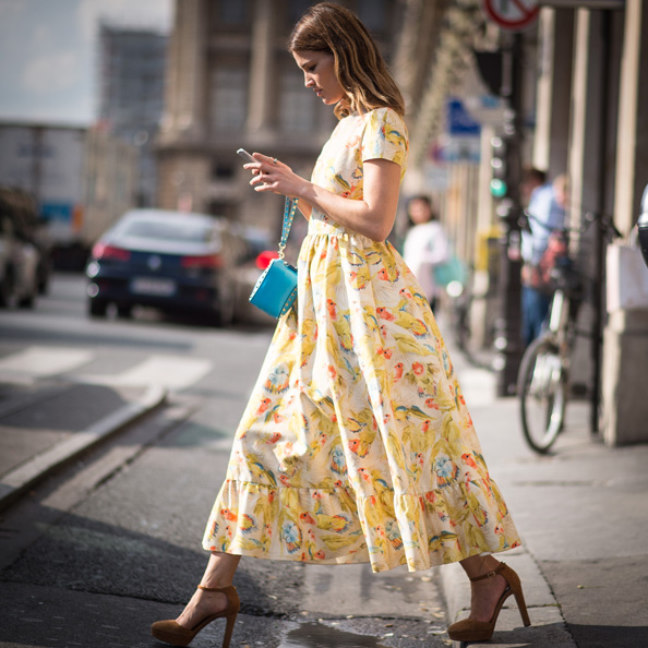Hanneli Mustaparta makes the most of the sunshine in a print dress.