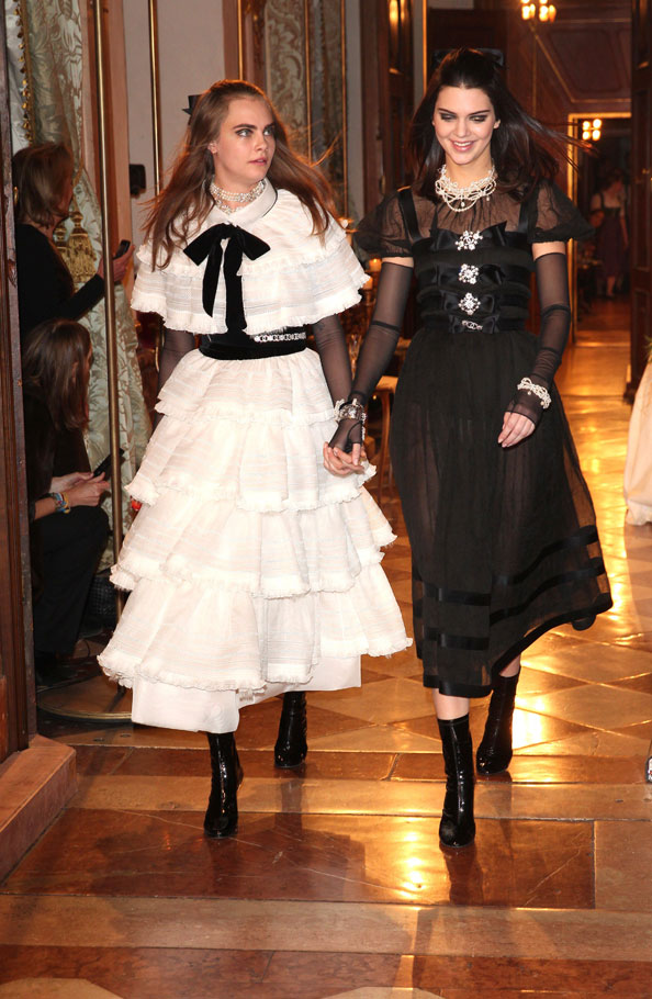 Model Cara Delevigne and Kendall Jenner during the Chanel Metiers dArt Collection