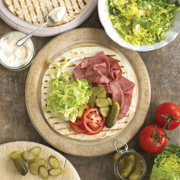 Pastrami, Dill Pickle and Tomato Wrap Recipe By Annabel Karmel