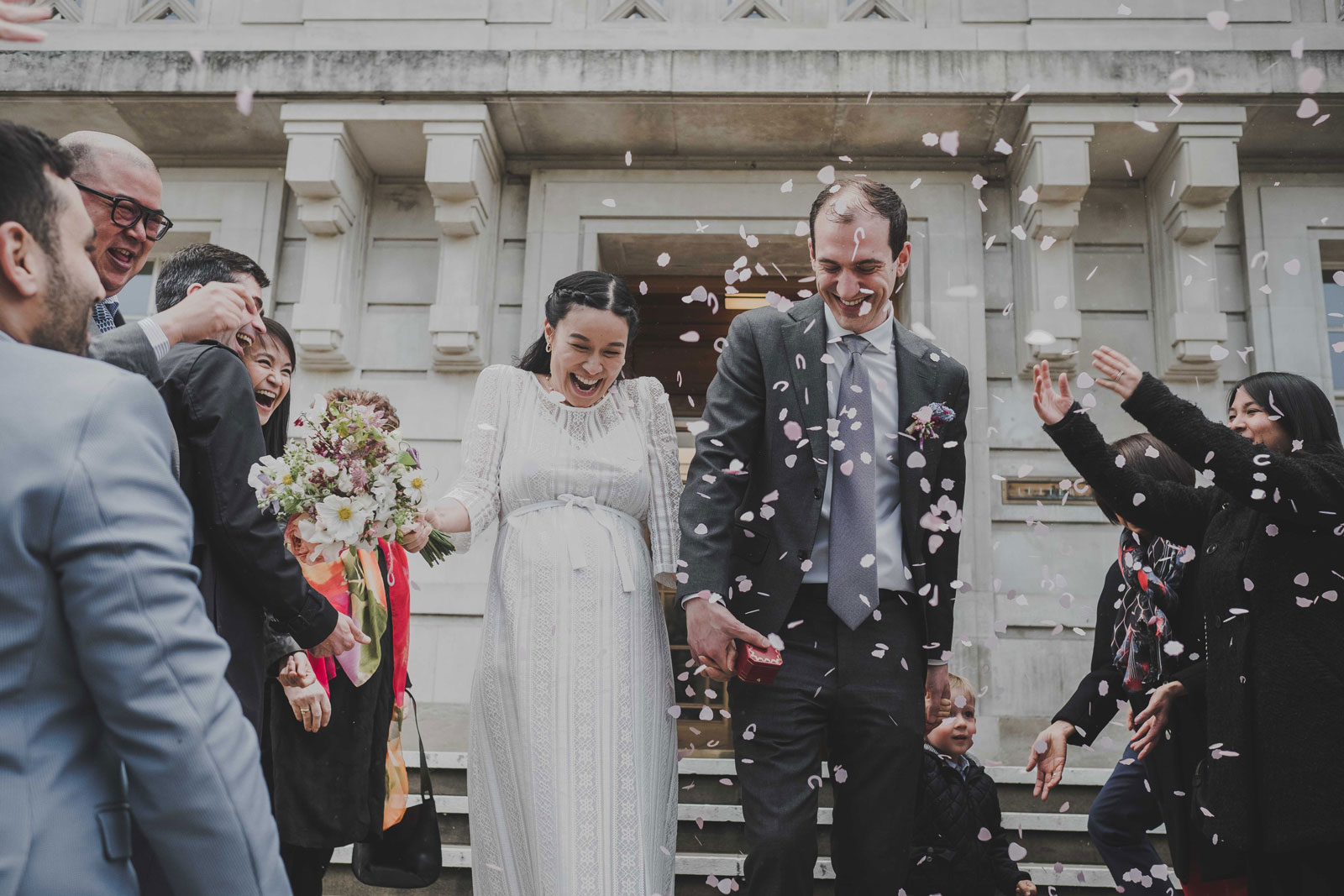 confetti photo of bride and groom leaving the town hall