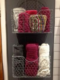 Galvanised wall towel storage.