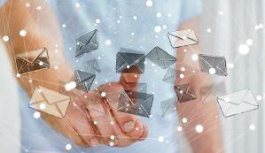 Image of hands touching flying emails. Copyright: sdecoret / 123RF Stock Photo