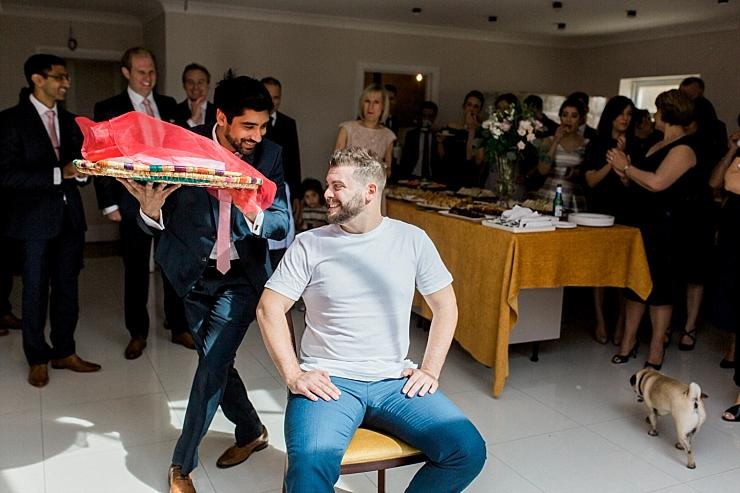 groom in greek napkin ceremony
