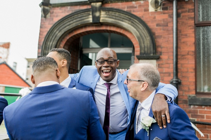 guests laughing outside church