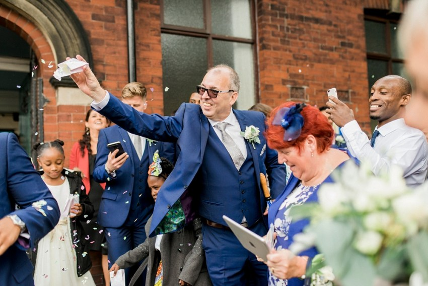 father of the groom throws confetti